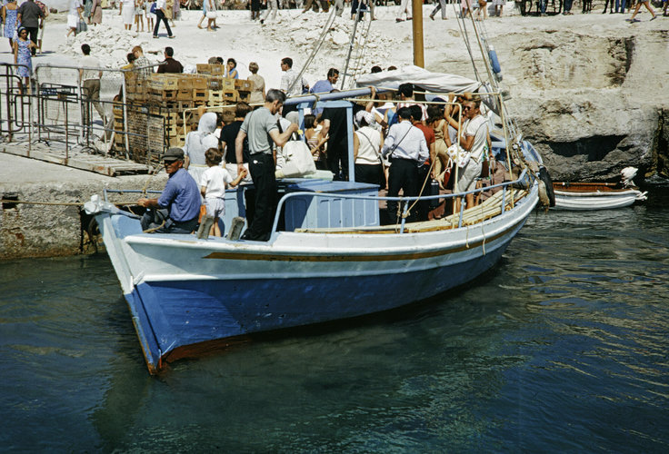 passengers departing boat docked at Aegina Island.jpg